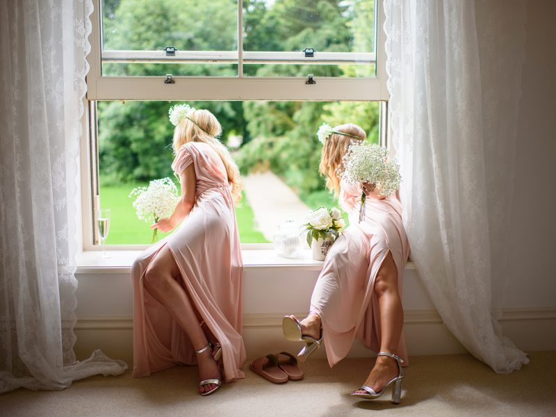 girls leaning out of window